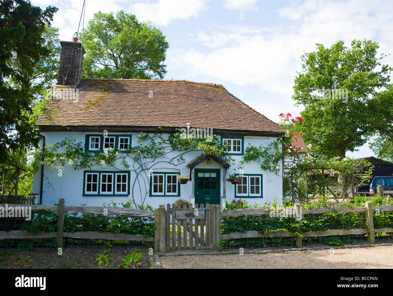 Traditional whitewashed English country cottage West Sussex UK - Stock Image