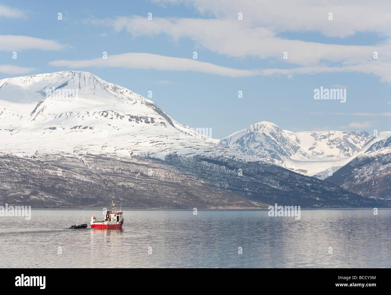 Small Norwegian fishing boat at Storfjord Skibotn Norway - Stock Image