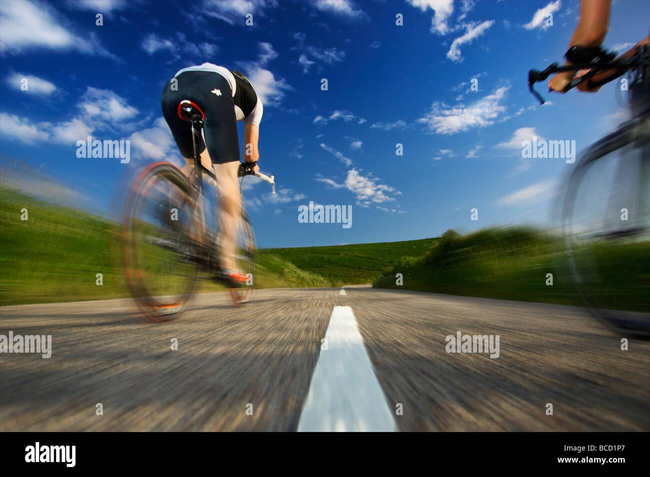World Quadrathlon champion 2008 - Andrew Byatt cycles past on the Cornwall coastal road - Stock Image