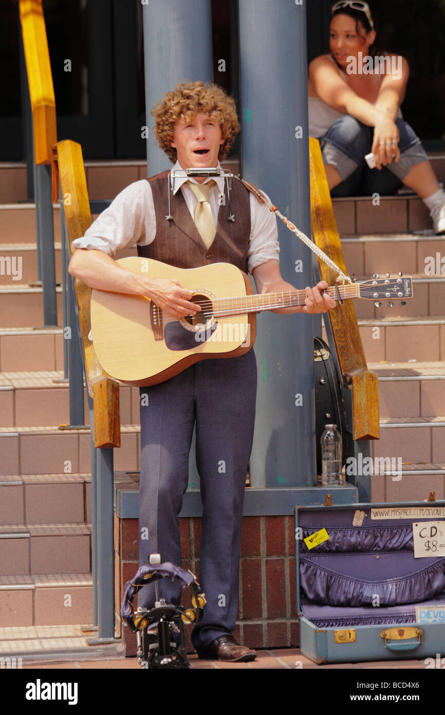 Young street musician playing in downtown Victoria Victoria British Columbia Canada - Stock Image
