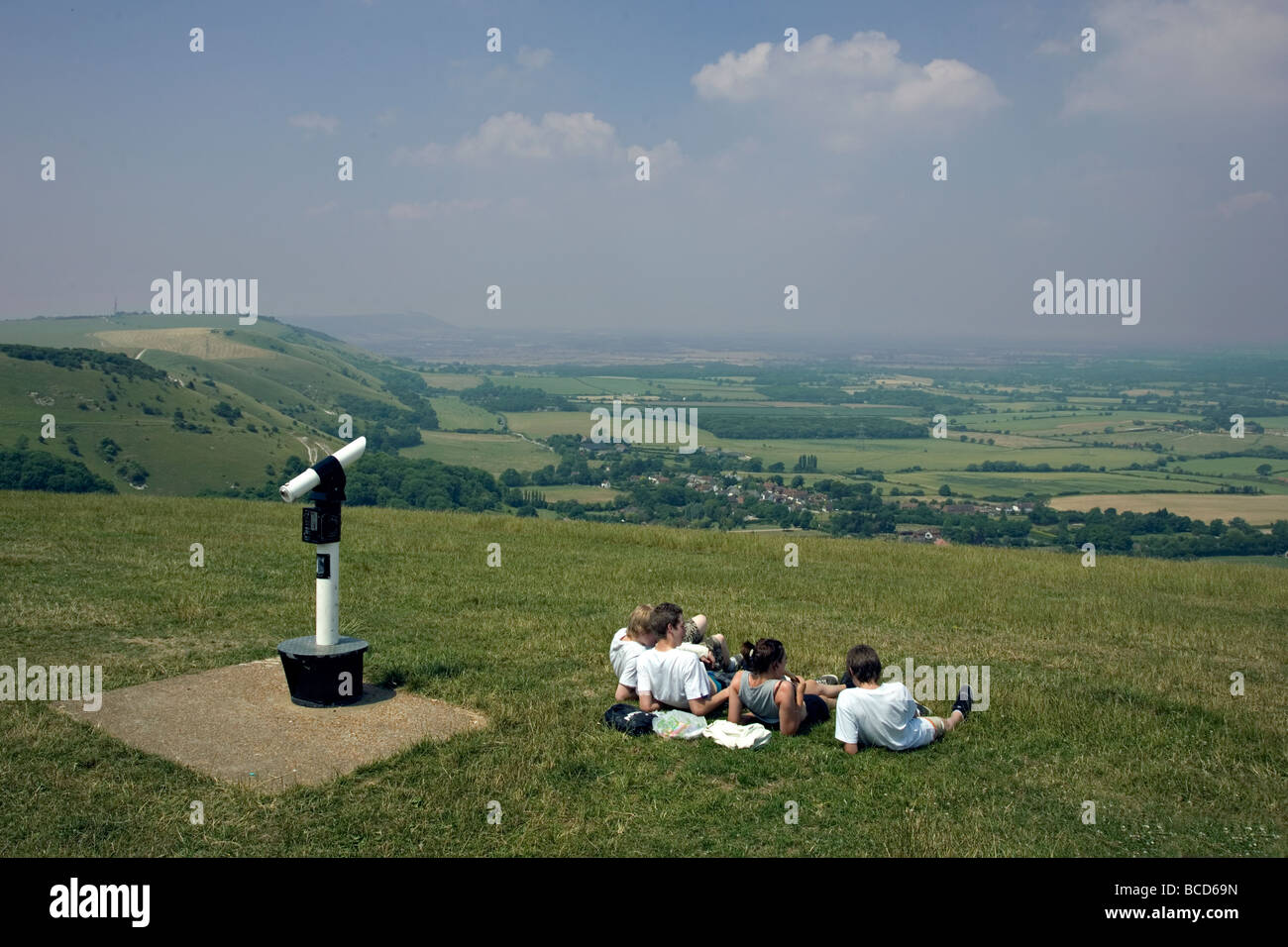 group of young people looking out from Devils dyke on the South Downs in England - Stock Image