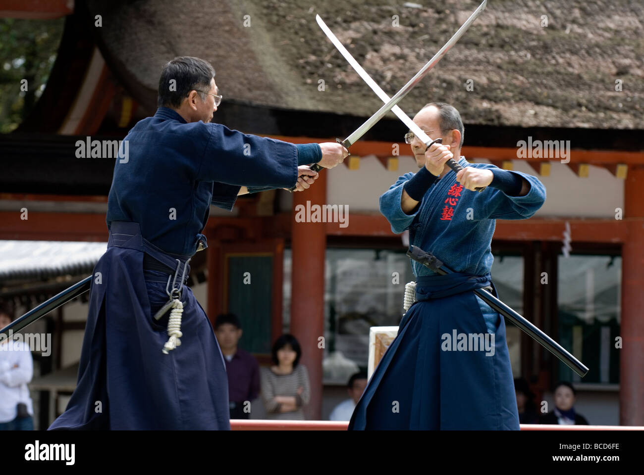 Two men engaged in a sword fight using real samurai swords