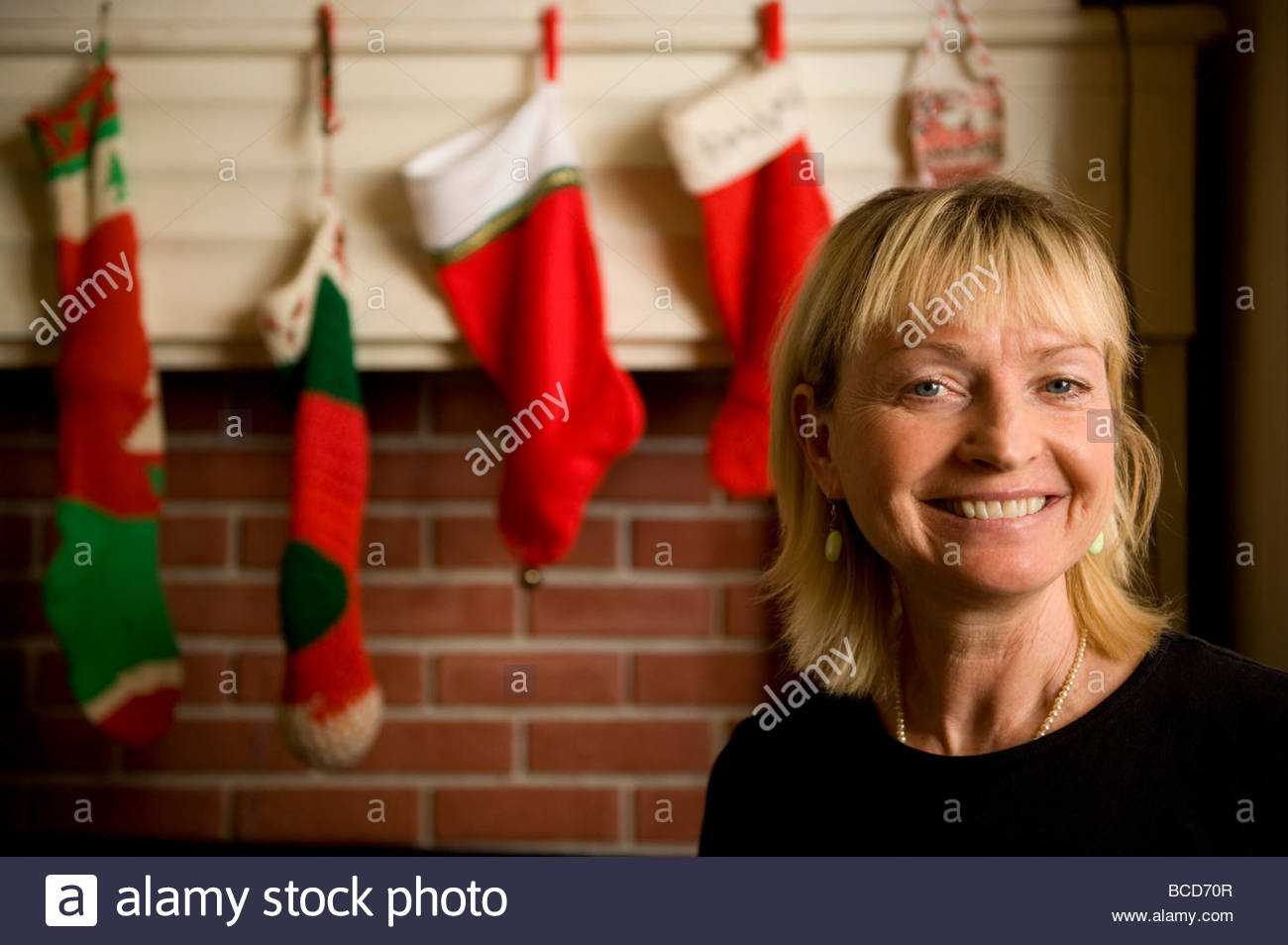 A woman during Christmastime. - Stock Image