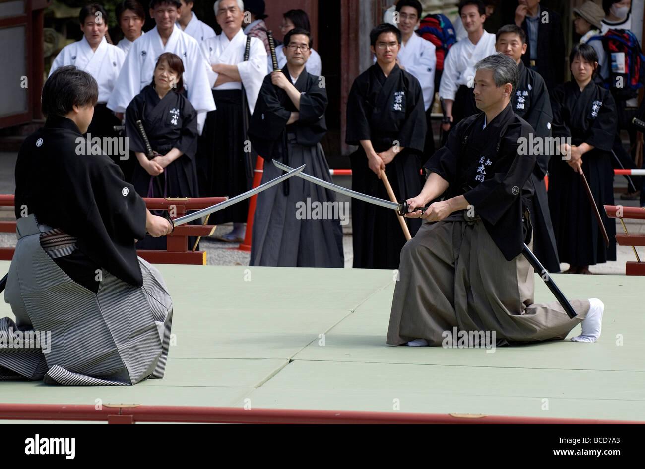 Two men sparring with real swords during a swordsmanship
