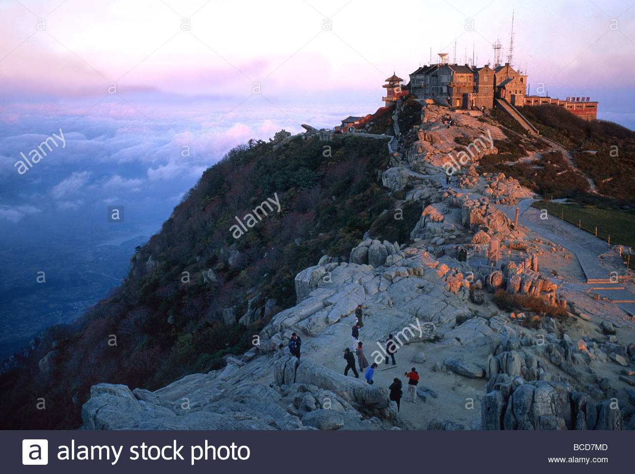 Visitors reach the peak of Mt. Tai during the Moon Festival. - Stock Image