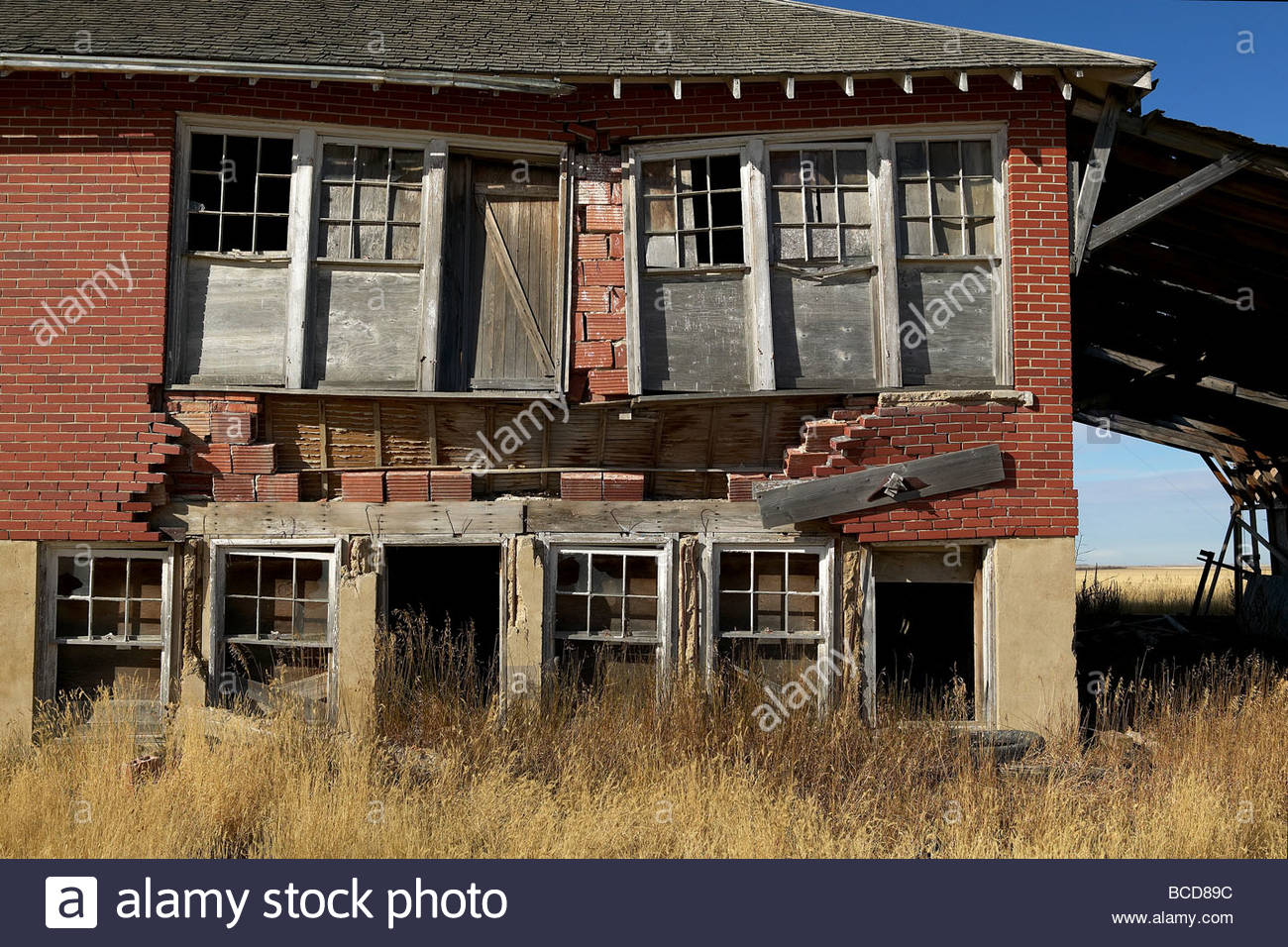 An old General Store in disrepair sits in a field. - Stock Image
