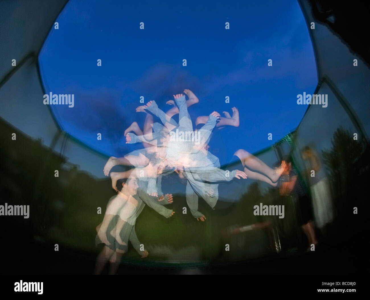 Trampoline Jumping Stock Photo