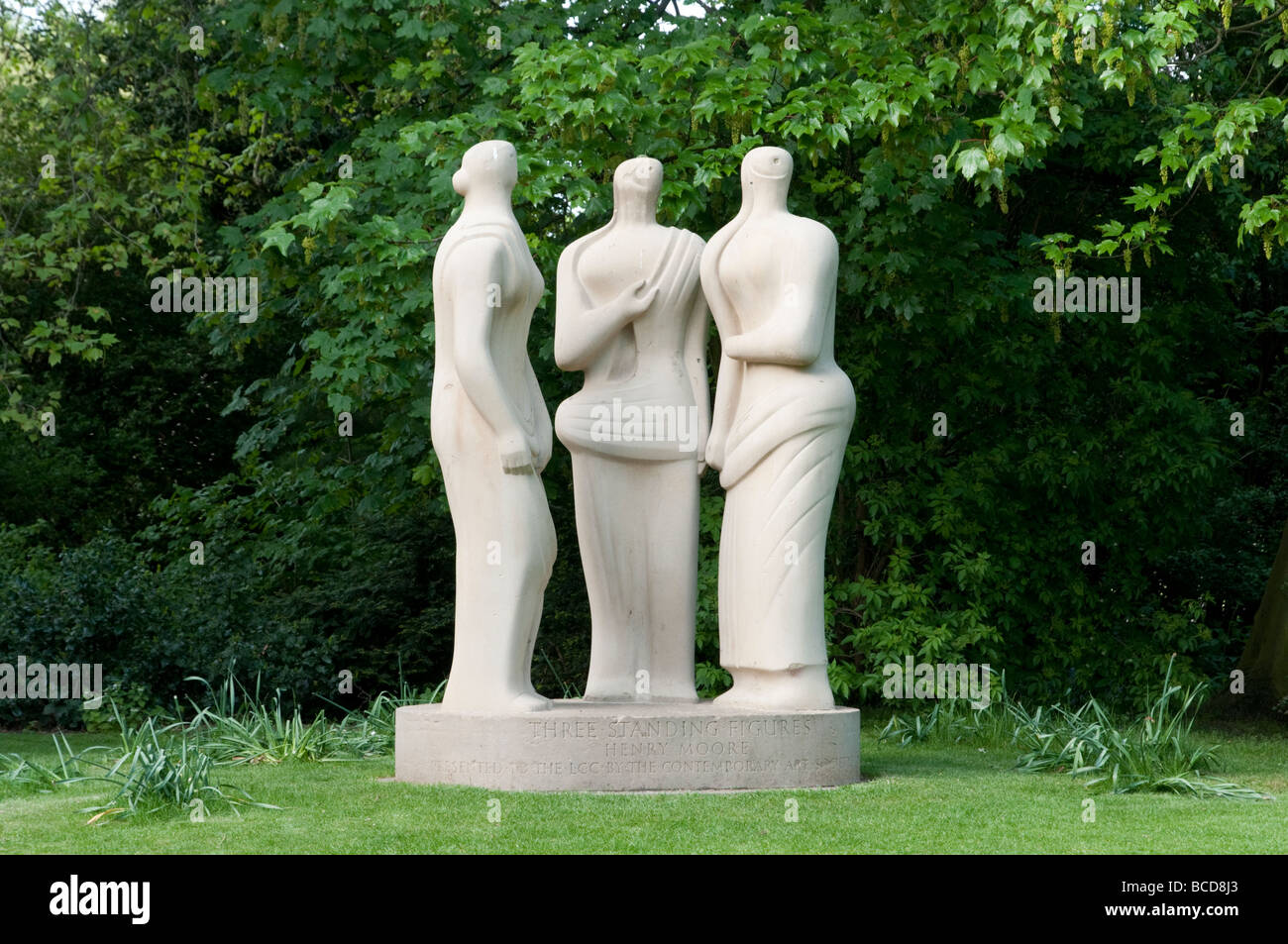Three Standing Figures sculpture by Henry Moore in Battersea Park, London, England, UK - Stock Image