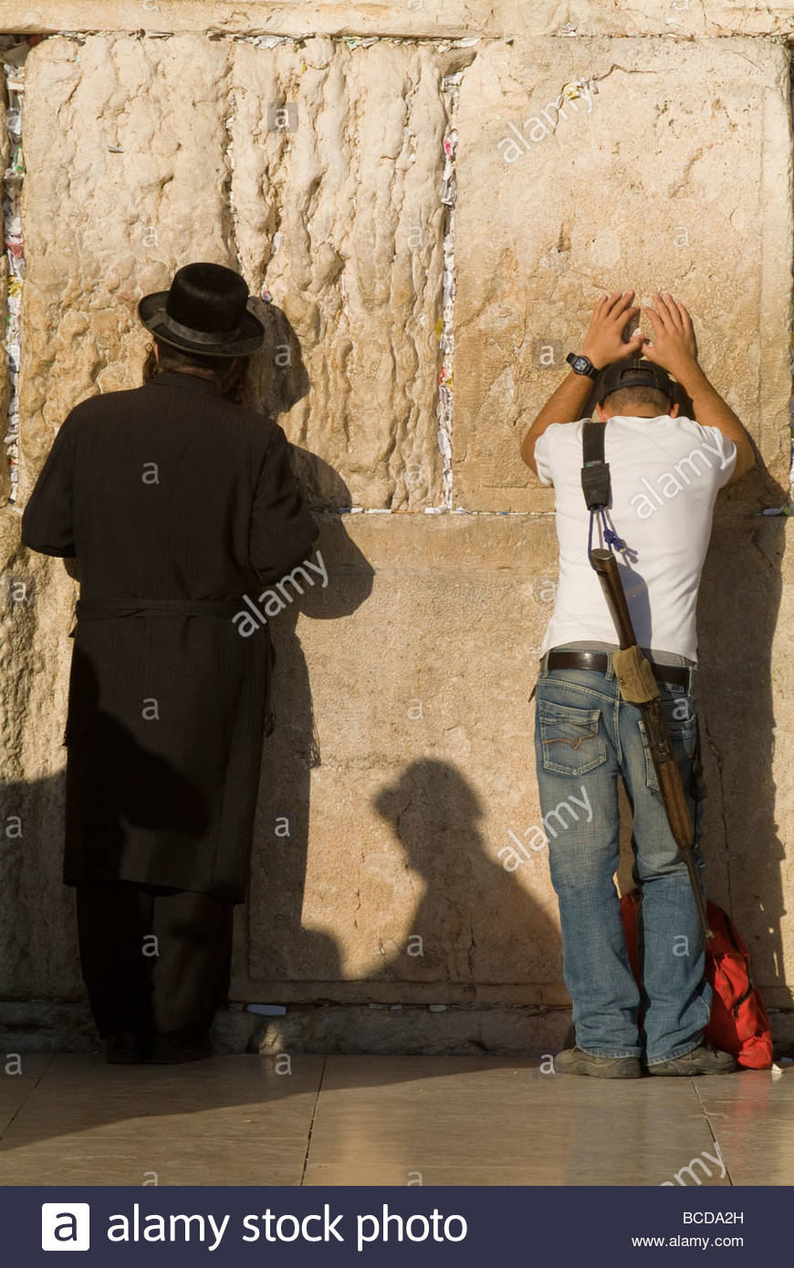 Orthodox Jew and soldier pray, Western Wall,Jewish Qt. Old City - Stock Image