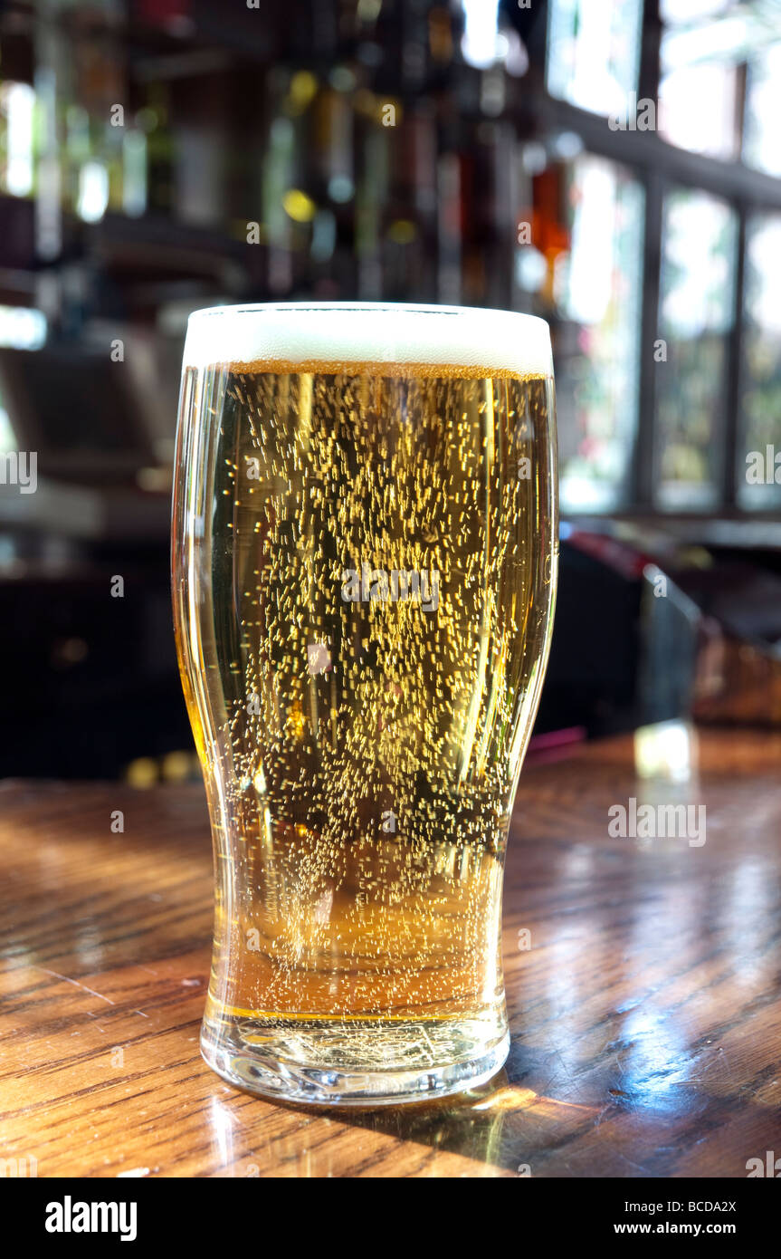 Close up of a pint of lager in a pub, England, UK - Stock Image