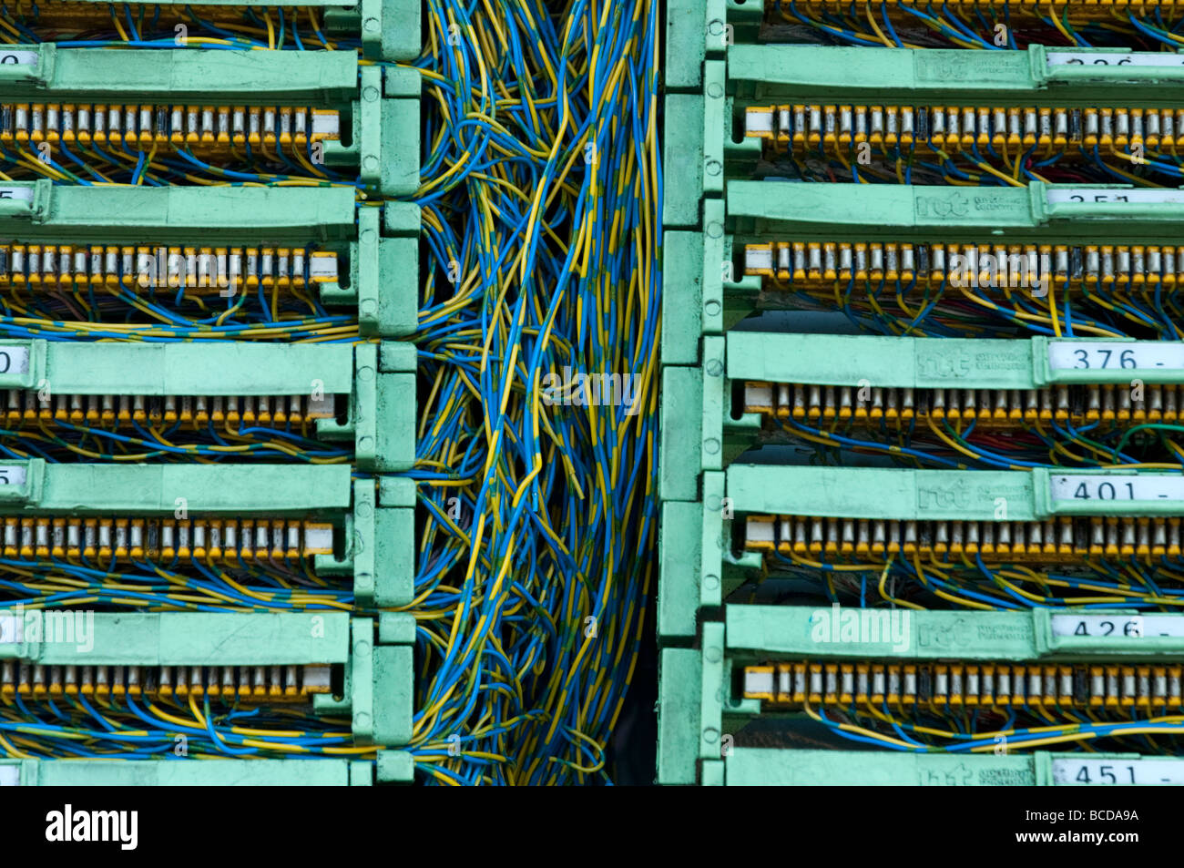 Tangle of telecommunications wires inside phone junction box, UK - Stock Image