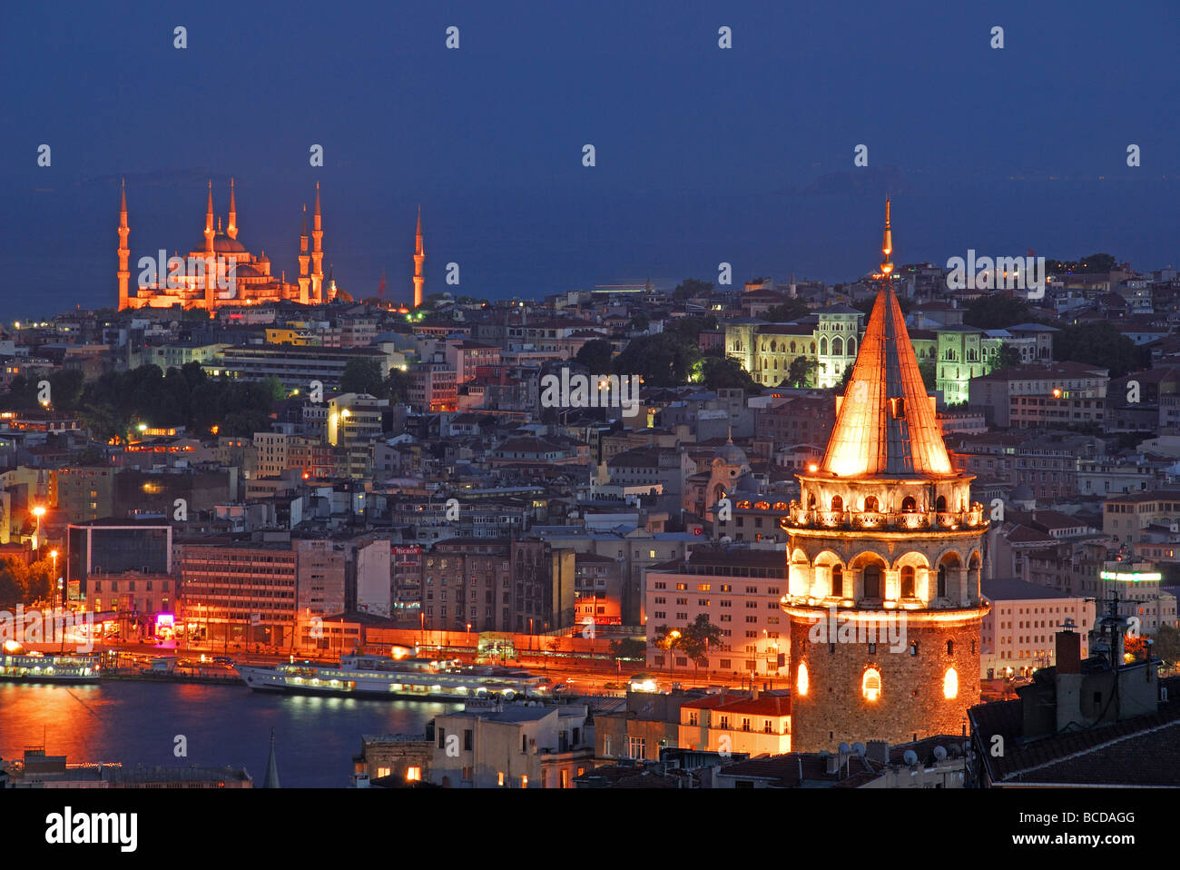 ISTANBUL, TURKEY. Night view of the city, with the Galata Tower on the right and the Blue Mosque in the distance. - Stock Image