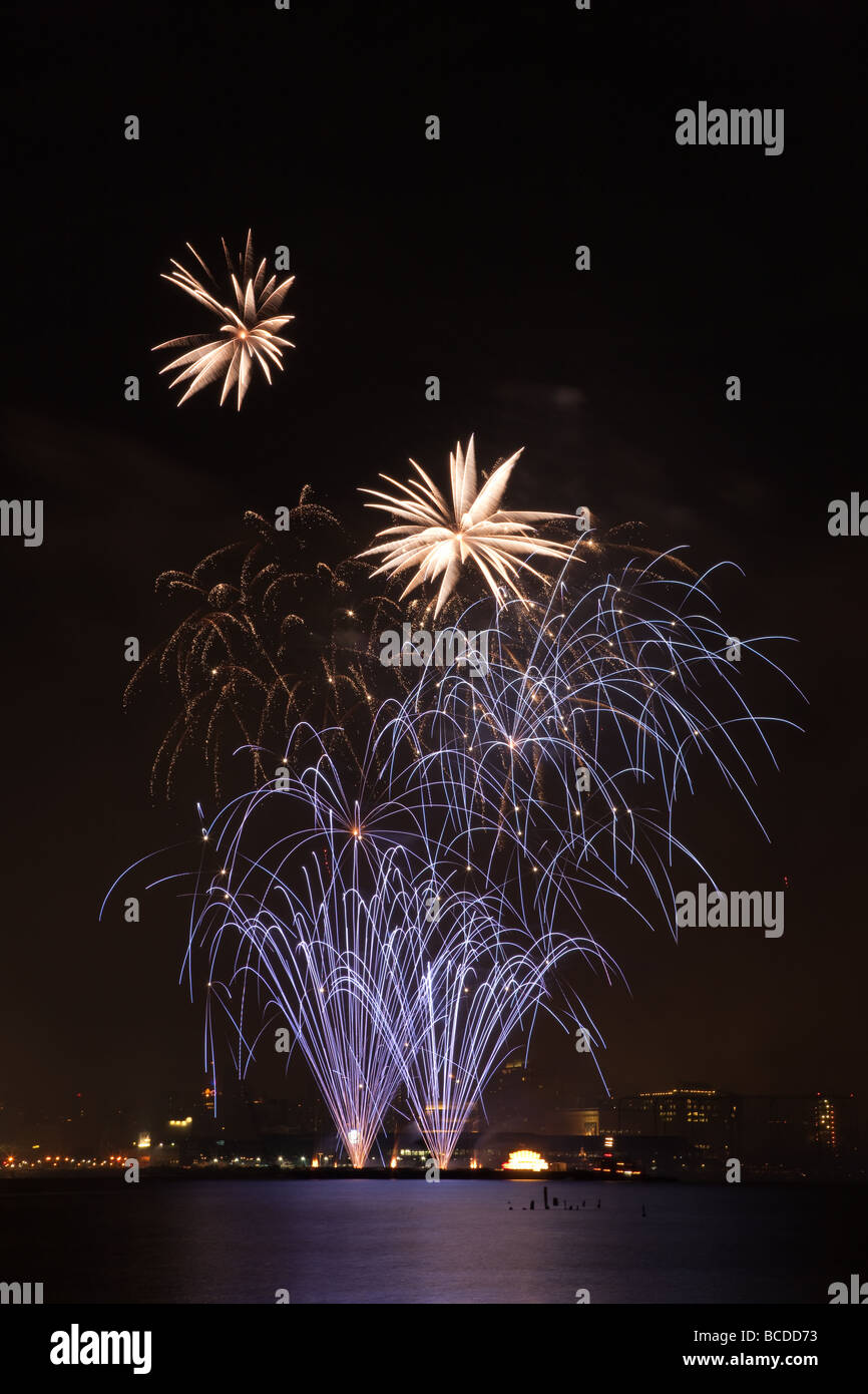 The annual Macy's Fourth of July fireworks extravaganza lights the sky over the Hudson river on July 4, 2009. Stock Photo