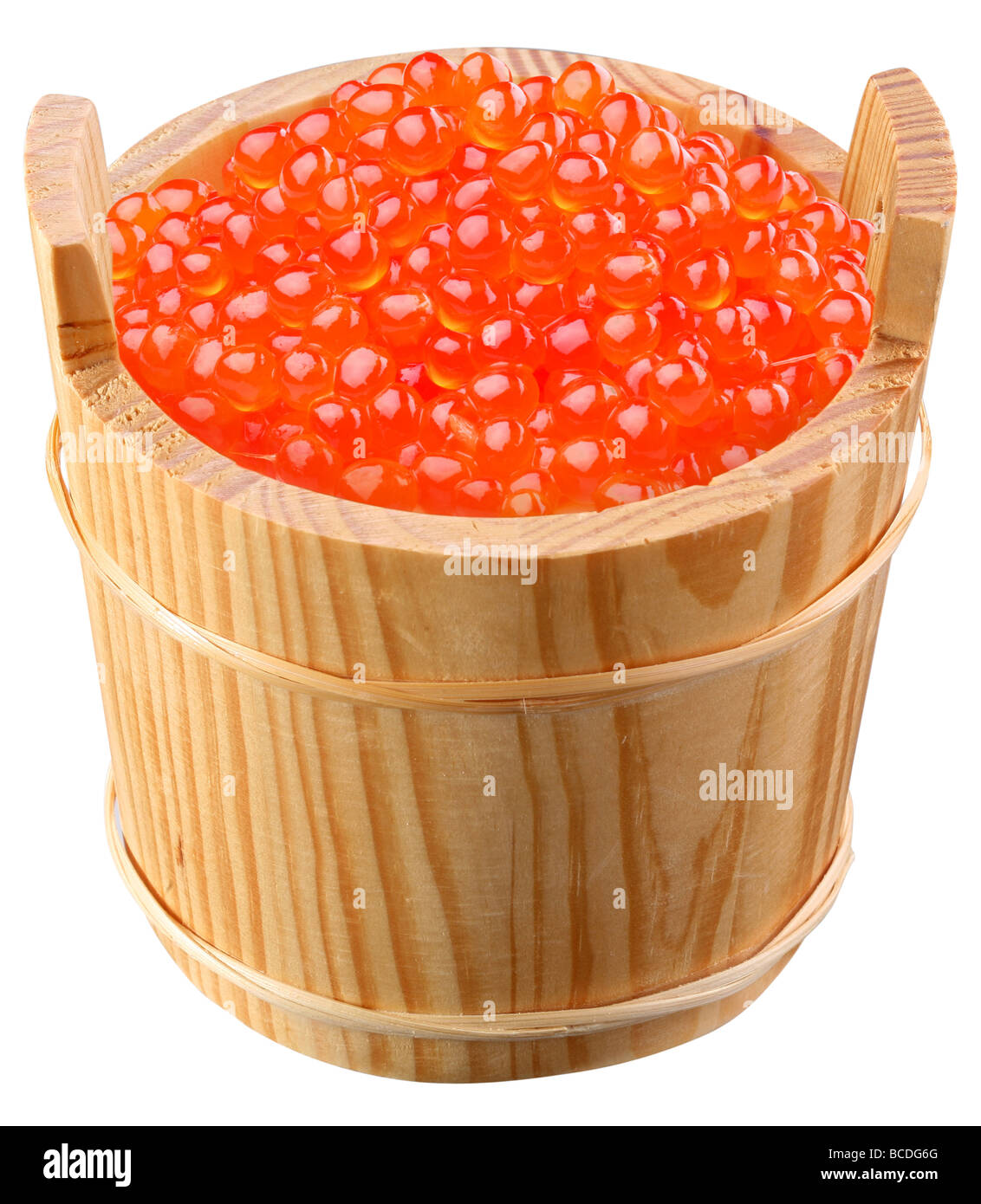 Red caviar is in a wooden bucket - Stock Image