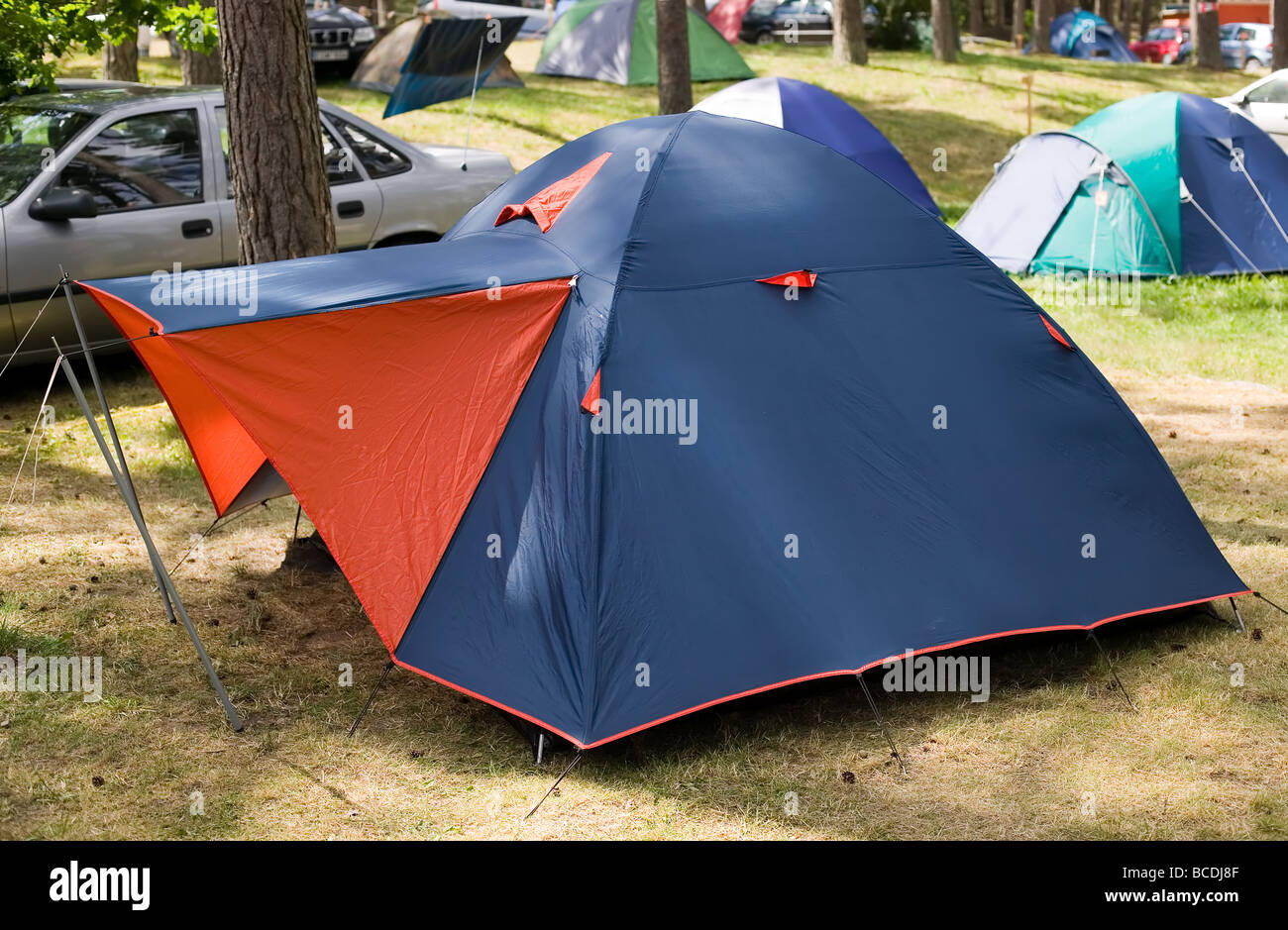 Blue tent with red entrance - Stock Image