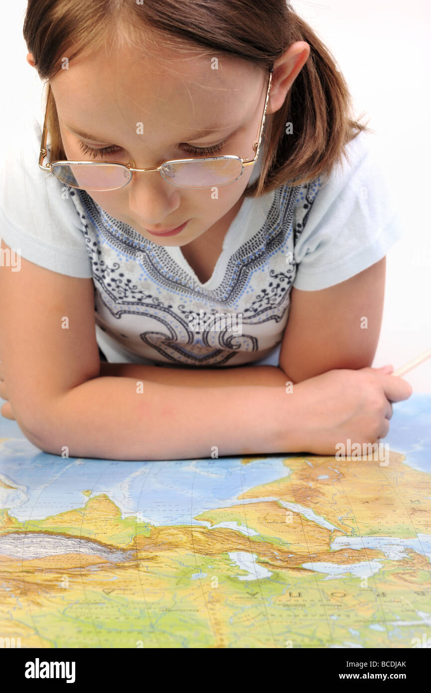 Girl exploring the geographic map of Eurasia - Stock Image
