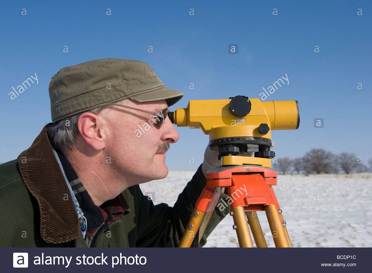 A man surveys a farm near Dunbar, Nebraska. - Stock Image