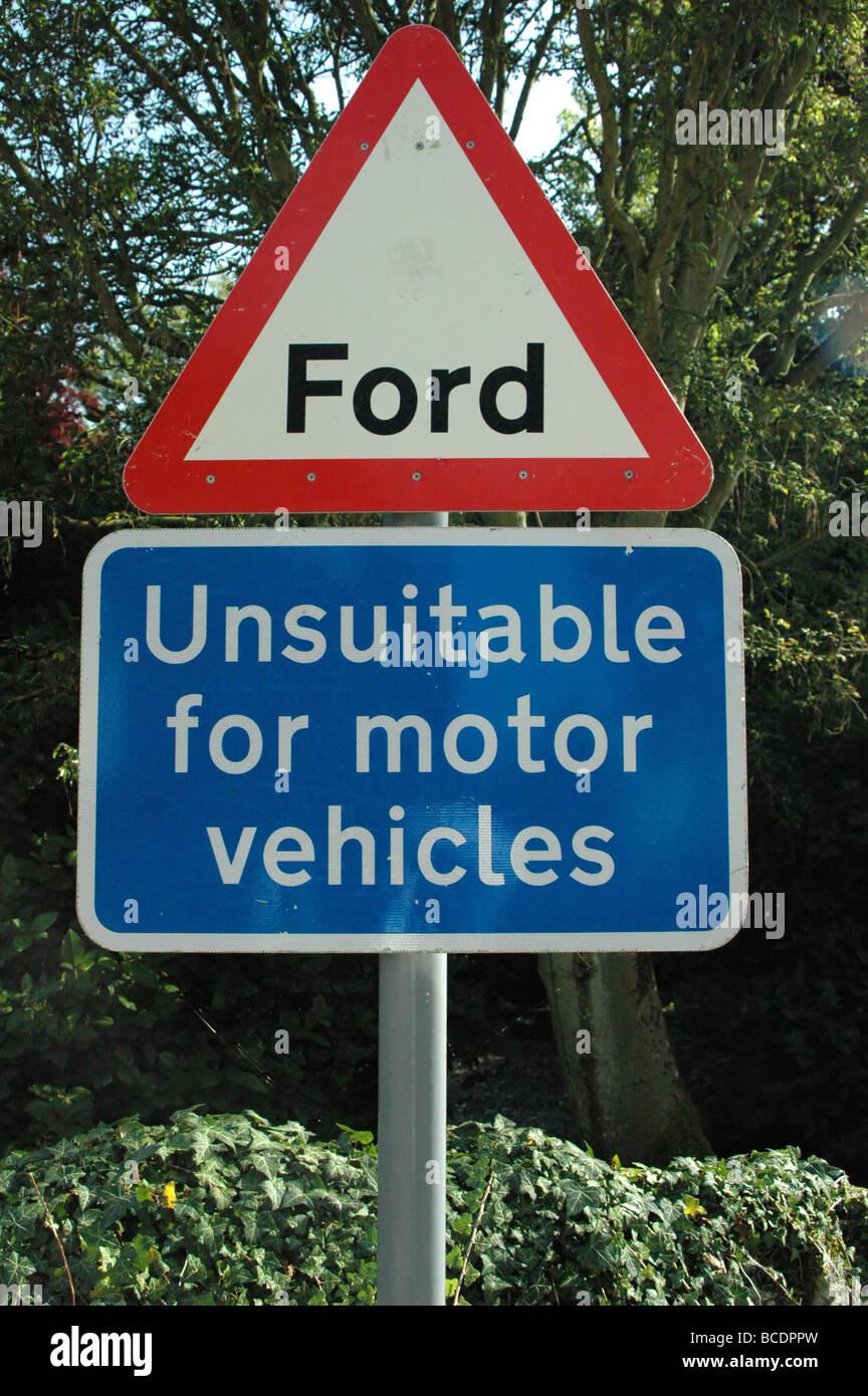 Warning Road Sign - Stock Image