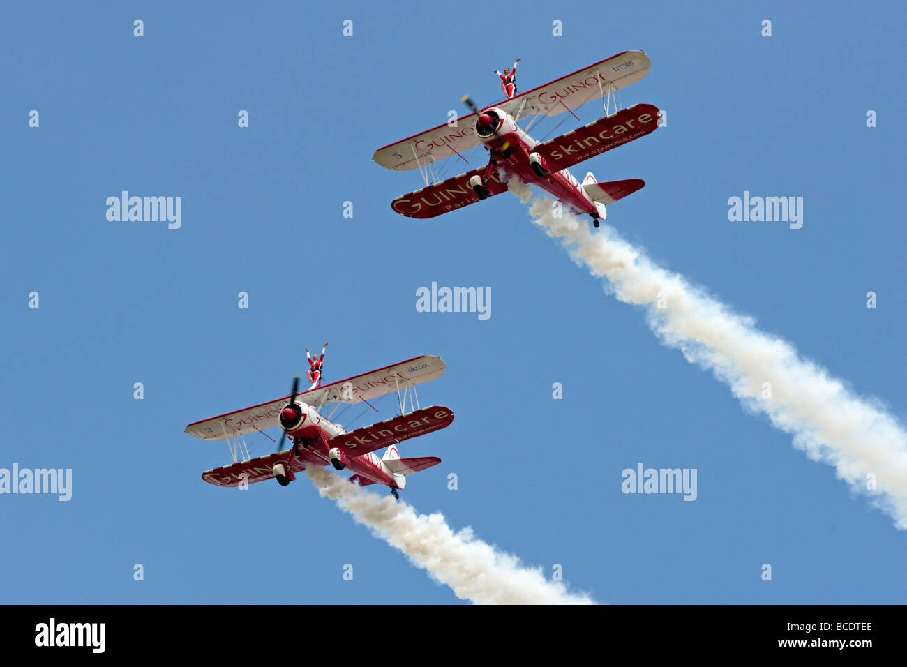 Two Boeing Stearman biplanes from Team Guinot perform their wingwalking feats at the Biggin Hill Airshow 2009. - Stock Image