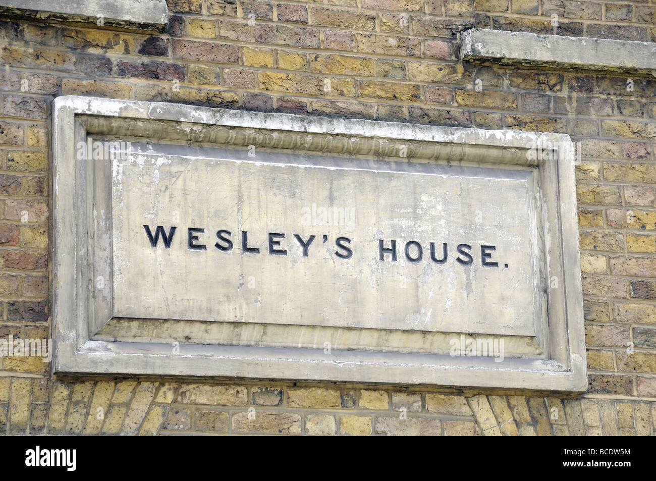 Stone in wall with Wesley's House written on it City Road London England UK - Stock Image