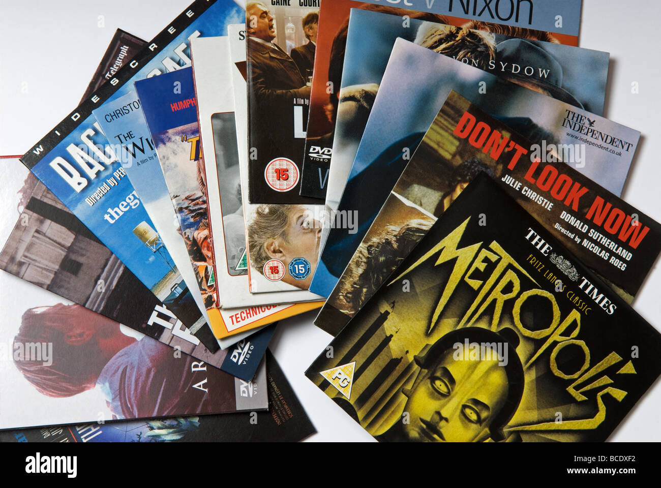 A selection of DVD's given away free with British newspapers - Stock Image