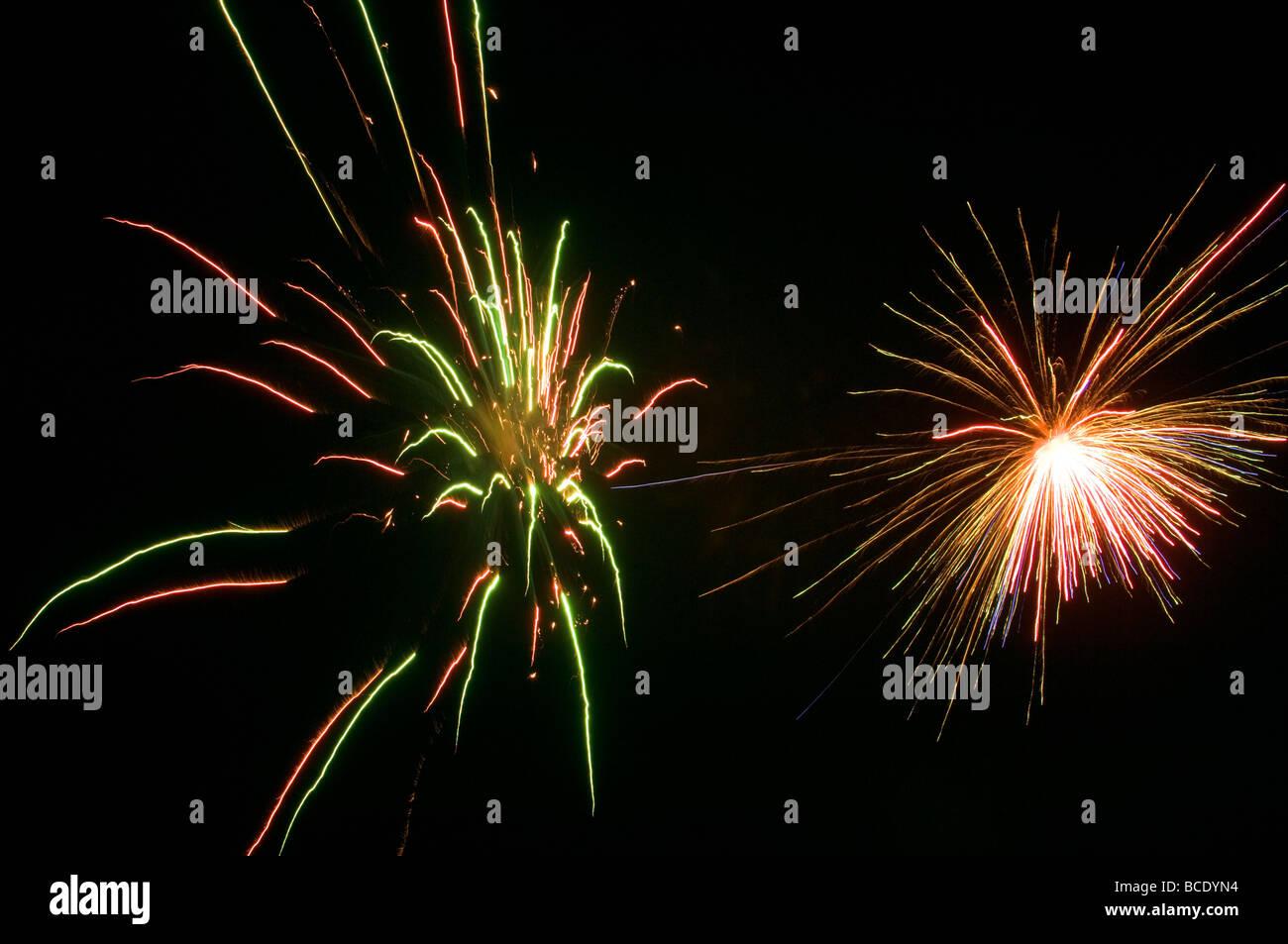 fireworks exploding fireworks celebration color colour design patriot patriotic explosions bang pop dazzel display - Stock Image