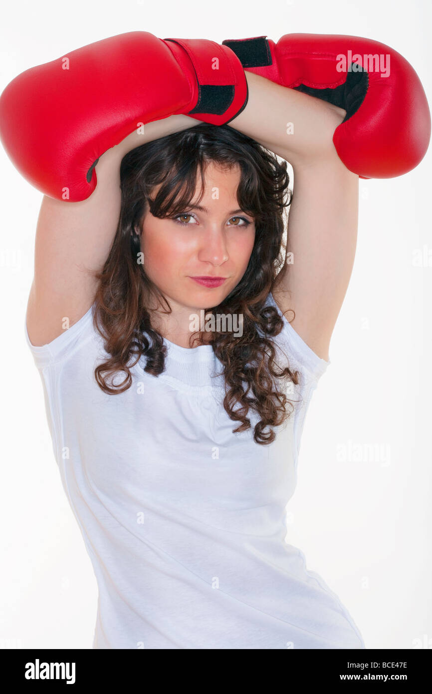 sport young woman with red boxing gloves - Stock Image