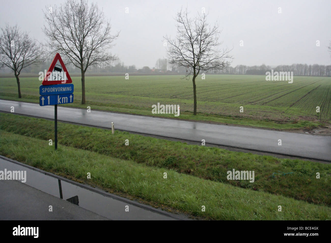 Slippery road warning in Europe. - Stock Image