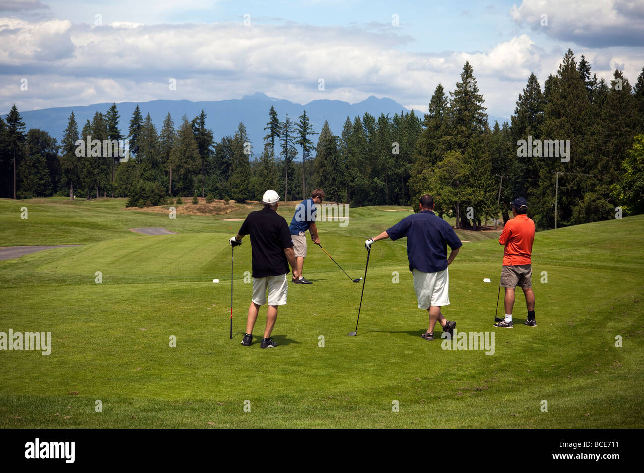 golfers at first hole on Redwood Golf Club, Langley, BC, Canada - Stock Image