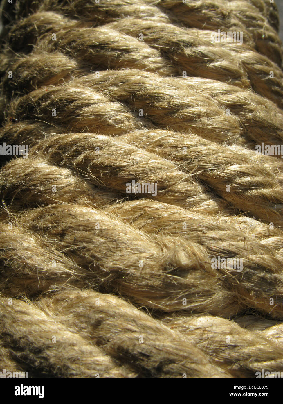 close up of coiled rope on winch on four wheel drive vehicle - Stock Image