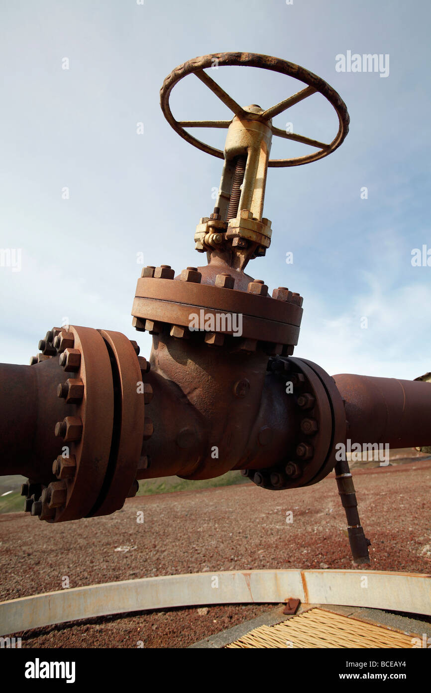 Valve on a borehole that delivers pressurized steam to the power station at Krafla, Iceland - Stock Image