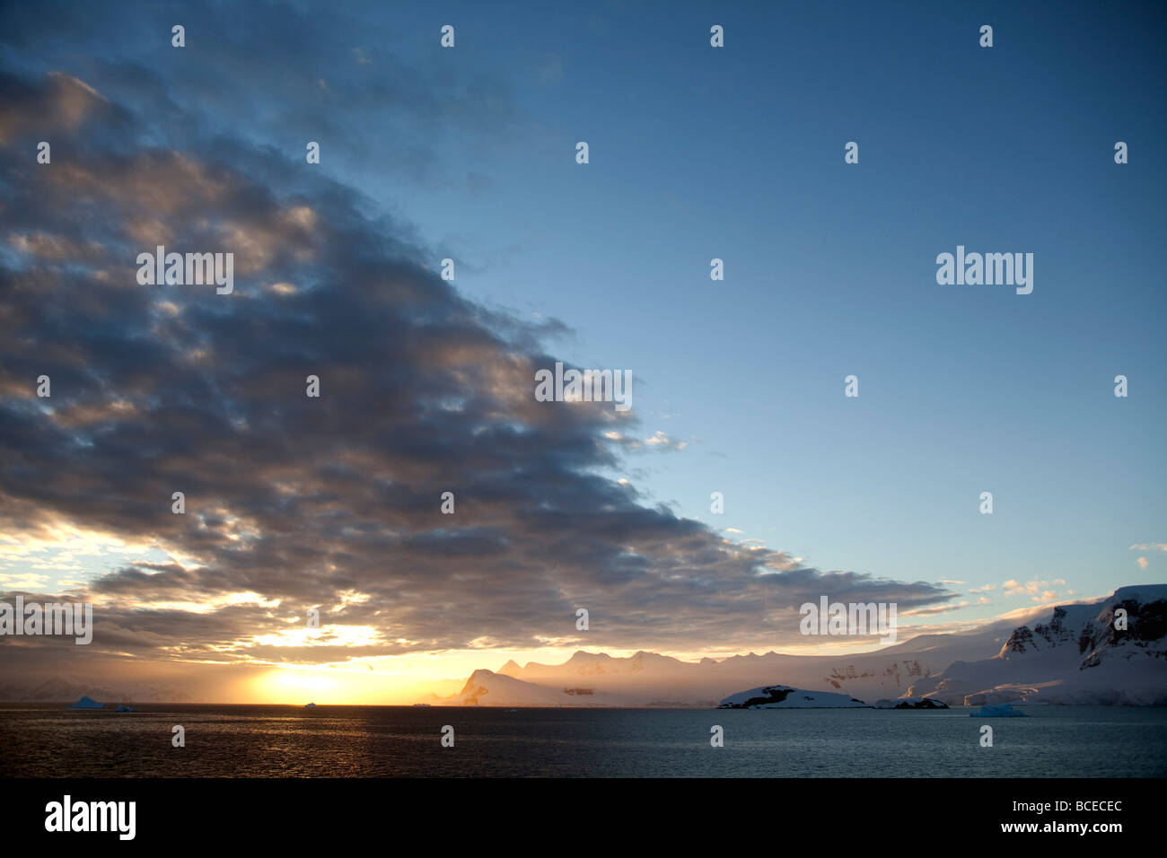 Antarctica, Peninsula. Sunset over the Antarctic Peninsula, the clouds of a cold front being occluded by an area - Stock Image