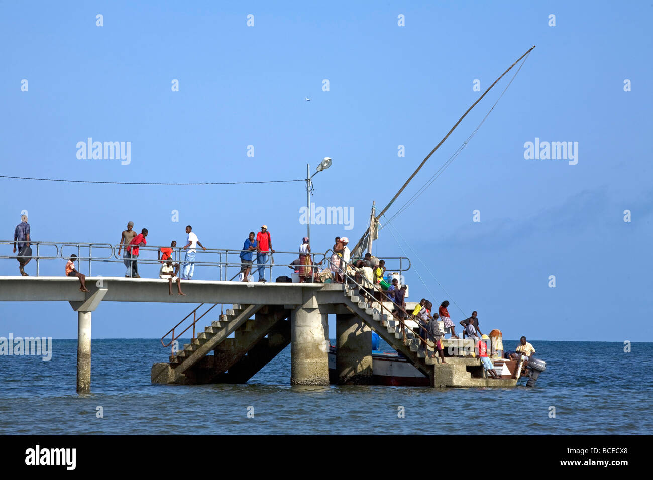 Mozambique, Inhaca Island. Local islanders carry their catch to the end of the jetty. Stock Photo