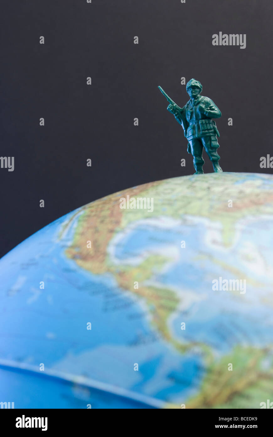 toy soldier on the globe - Stock Image