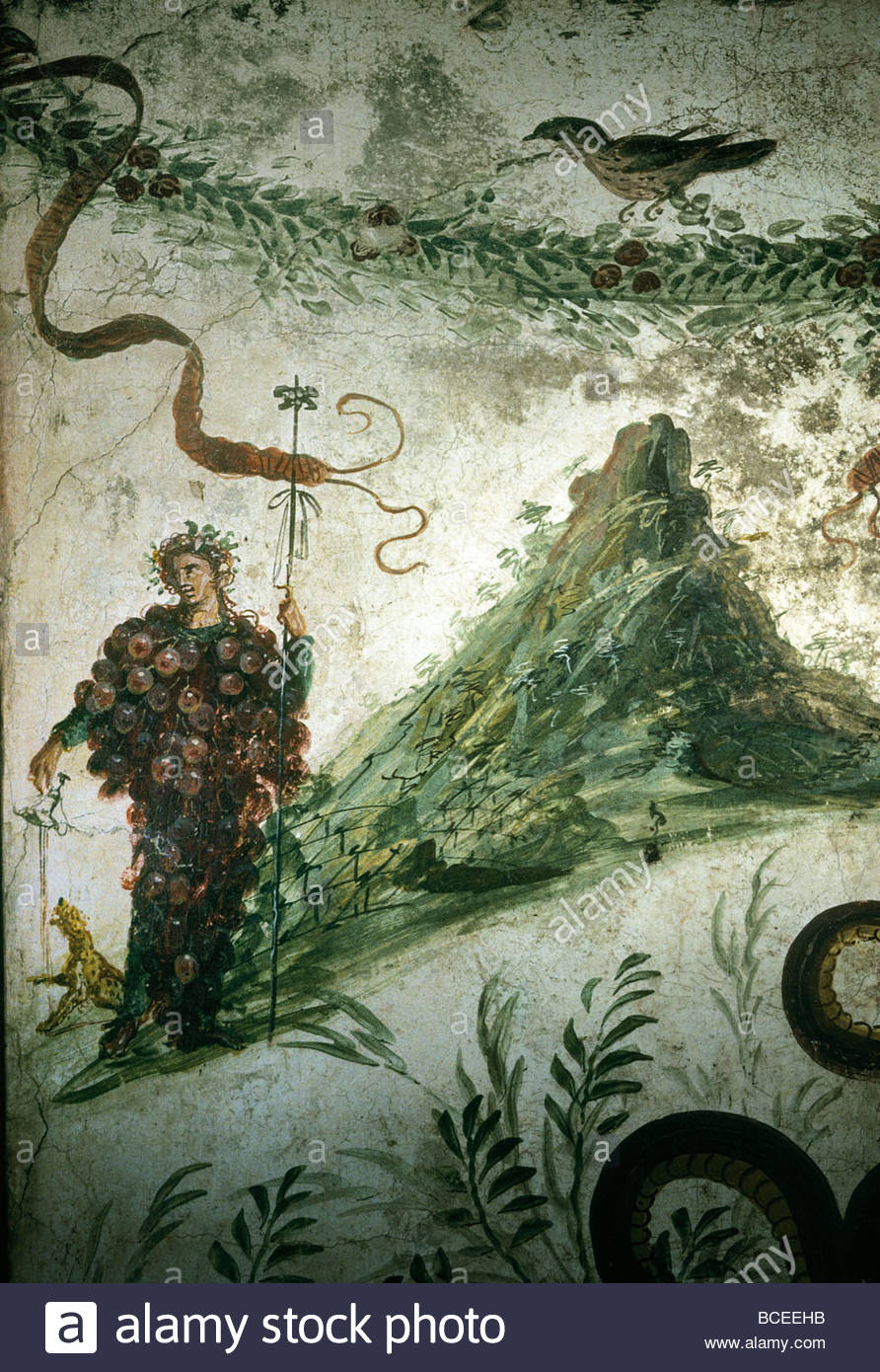 Bacchus, Roman god of wine, stands before Vesuvius in ancient fresco. - Stock Image