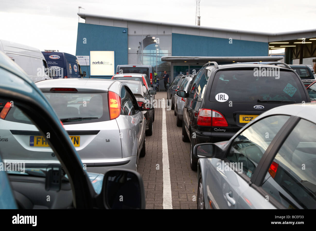 cars and vans queuing in line to board the norfolkline belfast to liverpool ferry at the terminal in belfast harbour - Stock Image