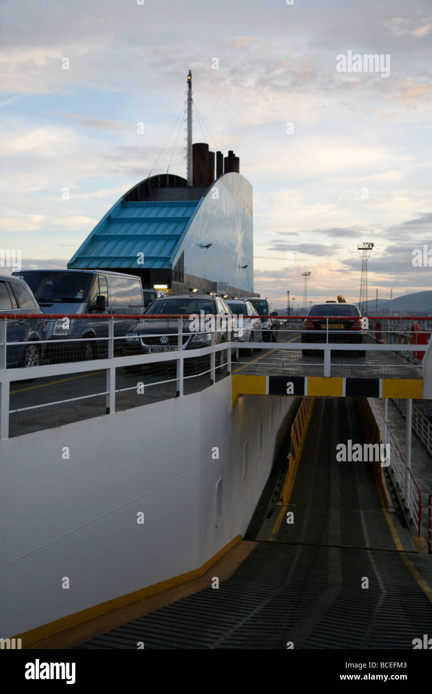 ramp smokestack and cars on the vehicle deck of the norfolkline passenger car ferry mersey viking in port in belfast - Stock Image
