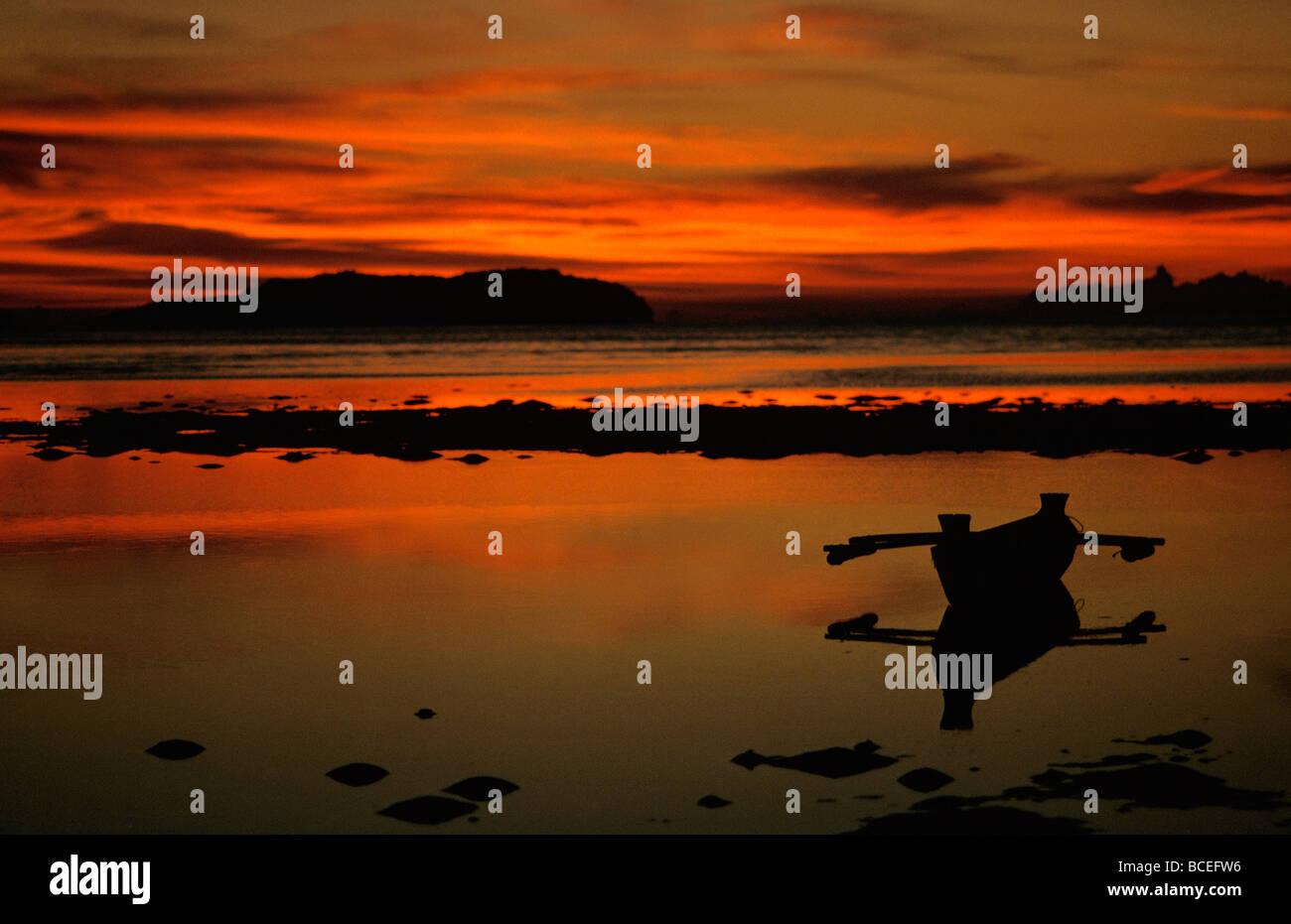 KOTA KINABALU  MALAYSIA , SUNSET ON SEA WITH CANOE - Stock Image