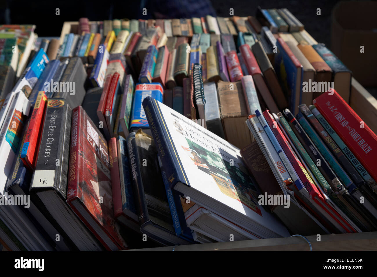 2nd hand books on a stall at a car boot sale in newtownabbey northern ireland uk - Stock Image