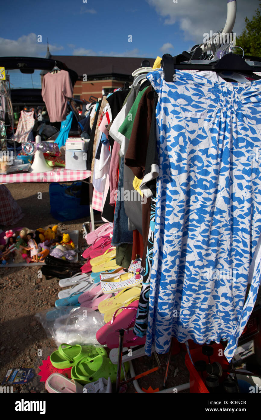 rail of 2nd hand womens clothes for sale at a car boot sale in newtownabbey northern ireland uk - Stock Image