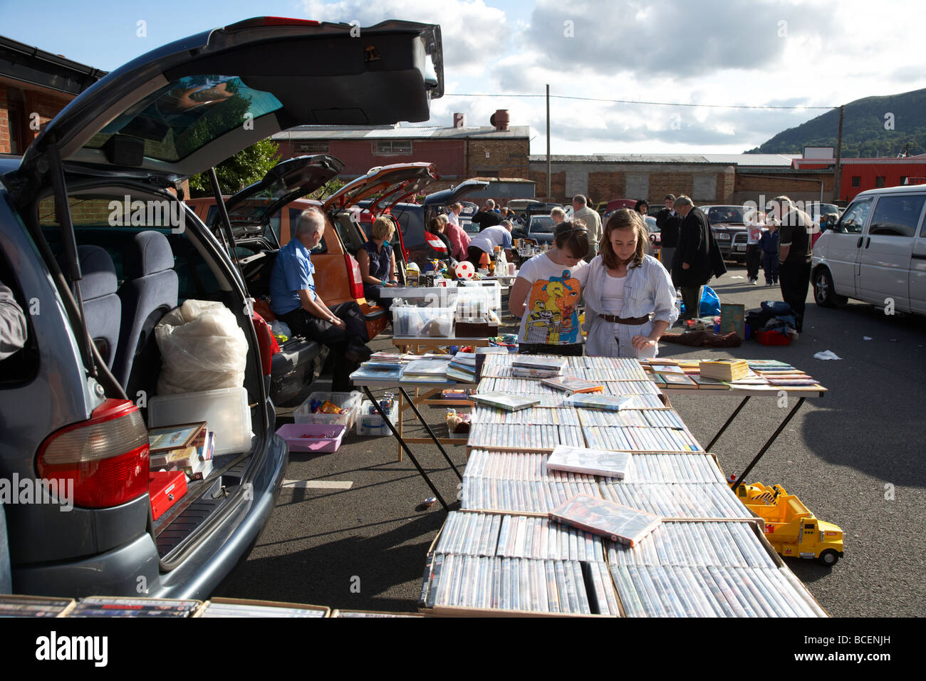 stalls with people browsing at a busy car boot sale in newtownabbey northern ireland uk - Stock Image