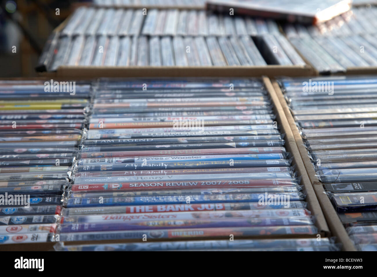2nd hand dvds on sale on a stall at a car boot sale in newtownabbey northern ireland uk - Stock Image