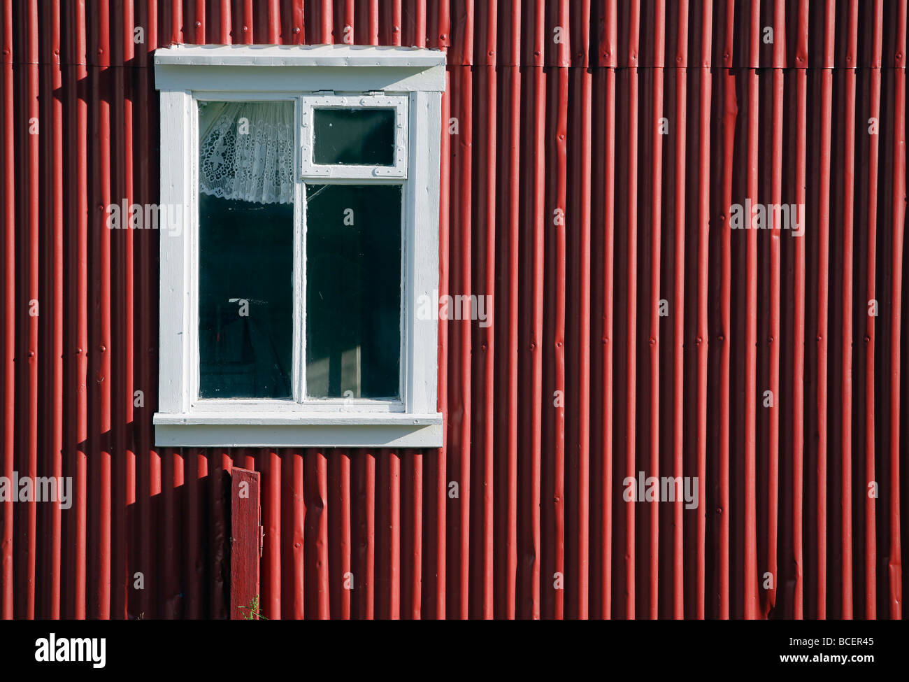 Bright red tin siding on a traditional, Seyðisfjörður, Iceland - Stock Image