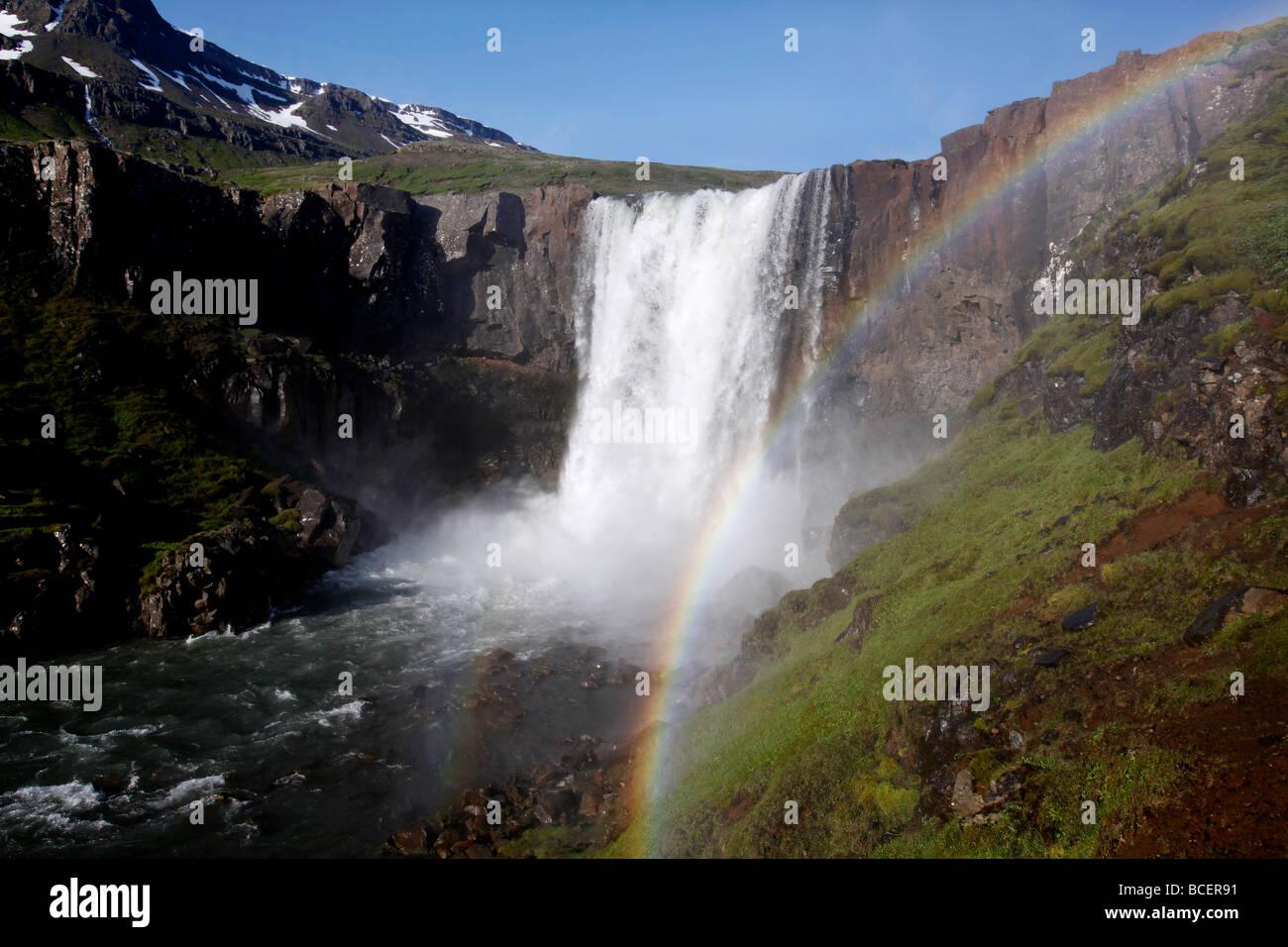 Waterfall rainbow, Seyðisfjörður, Iceland - Stock Image