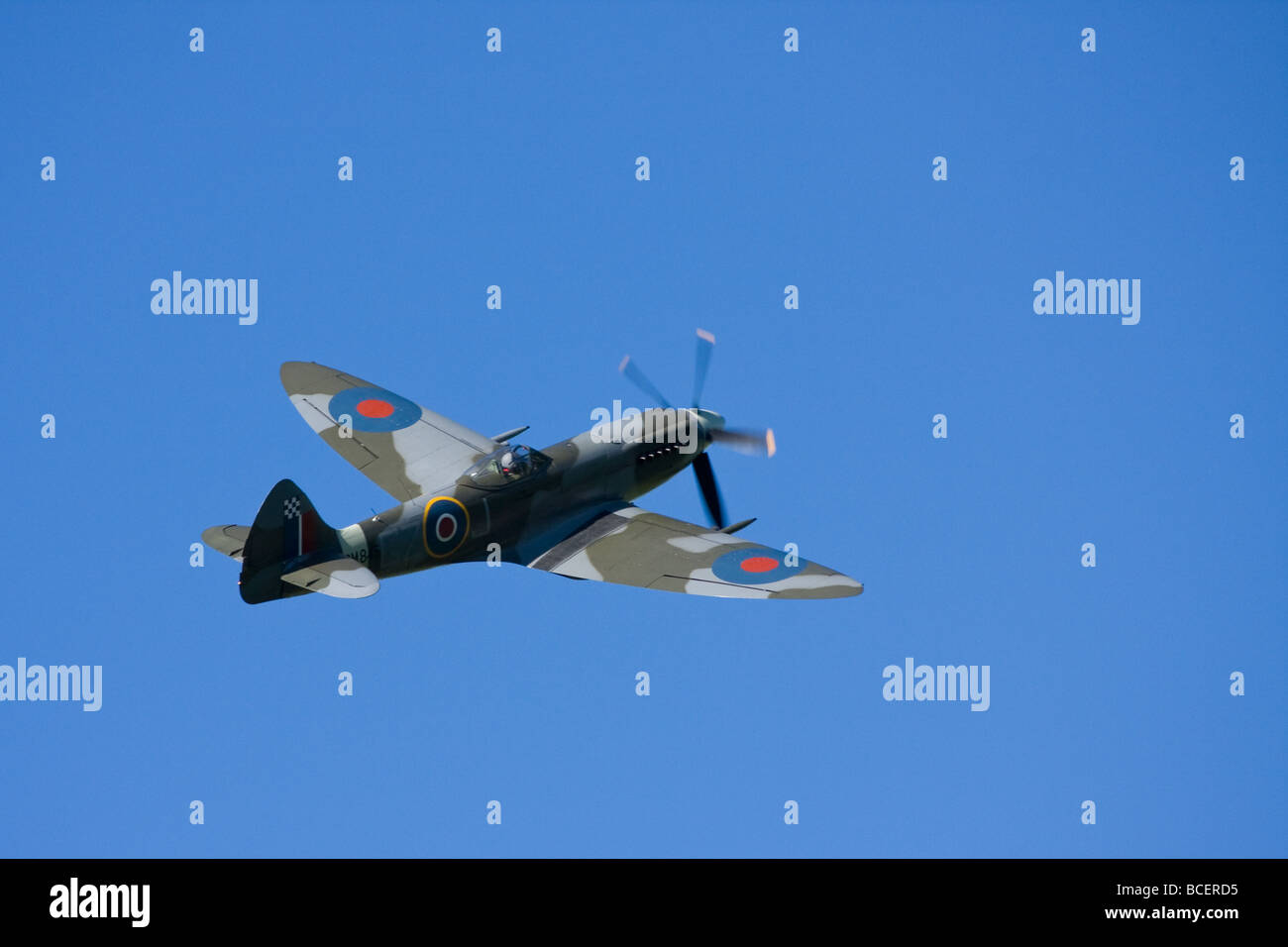 Old Spitfire propeller plane at an airshow - Stock Image