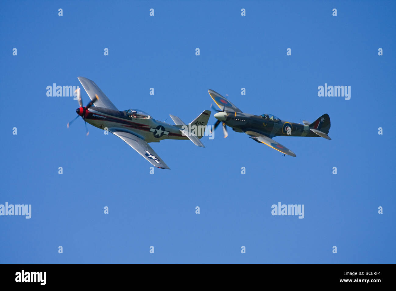 Old Spitfire and Mustang propeller planes at an airshow - Stock Image