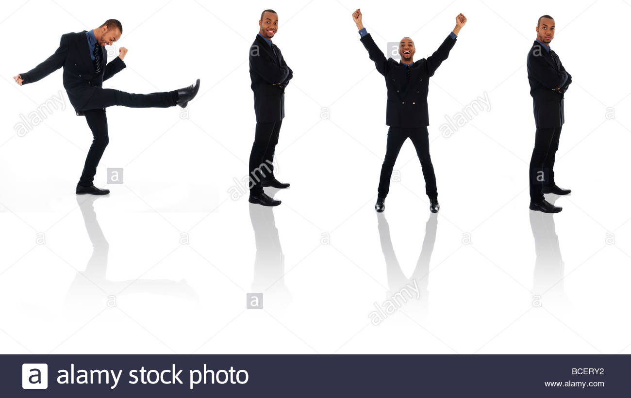 dancing happy winner business man on white poses - Stock Image