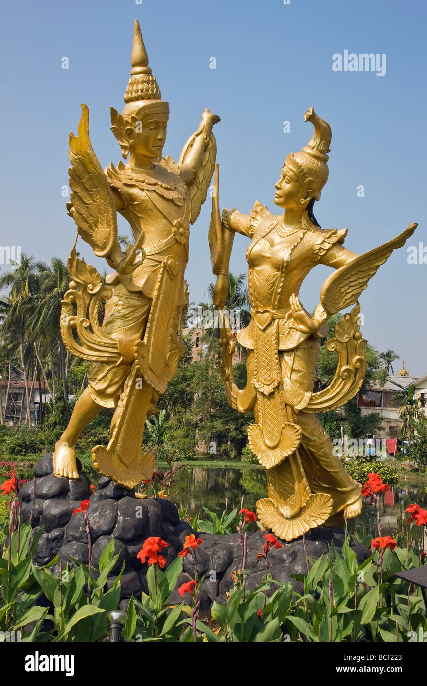 Myanmar, Burma, Yangon. A statue of the mythical creatures Kannari and Kannara - half human, half bird - in the - Stock Image