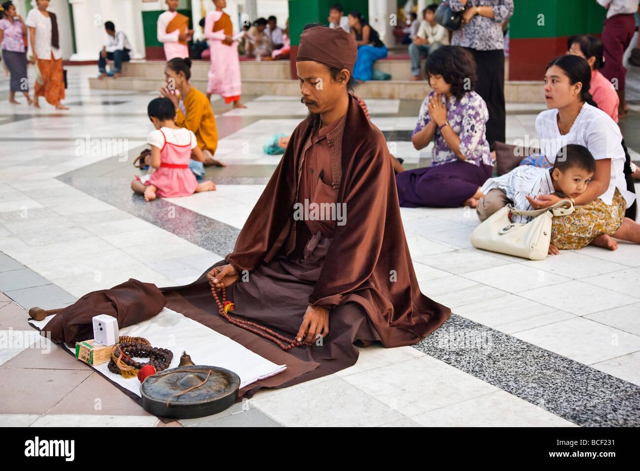Myanmar, Burma, Yangon  A Tibetan Buddhist monk and others