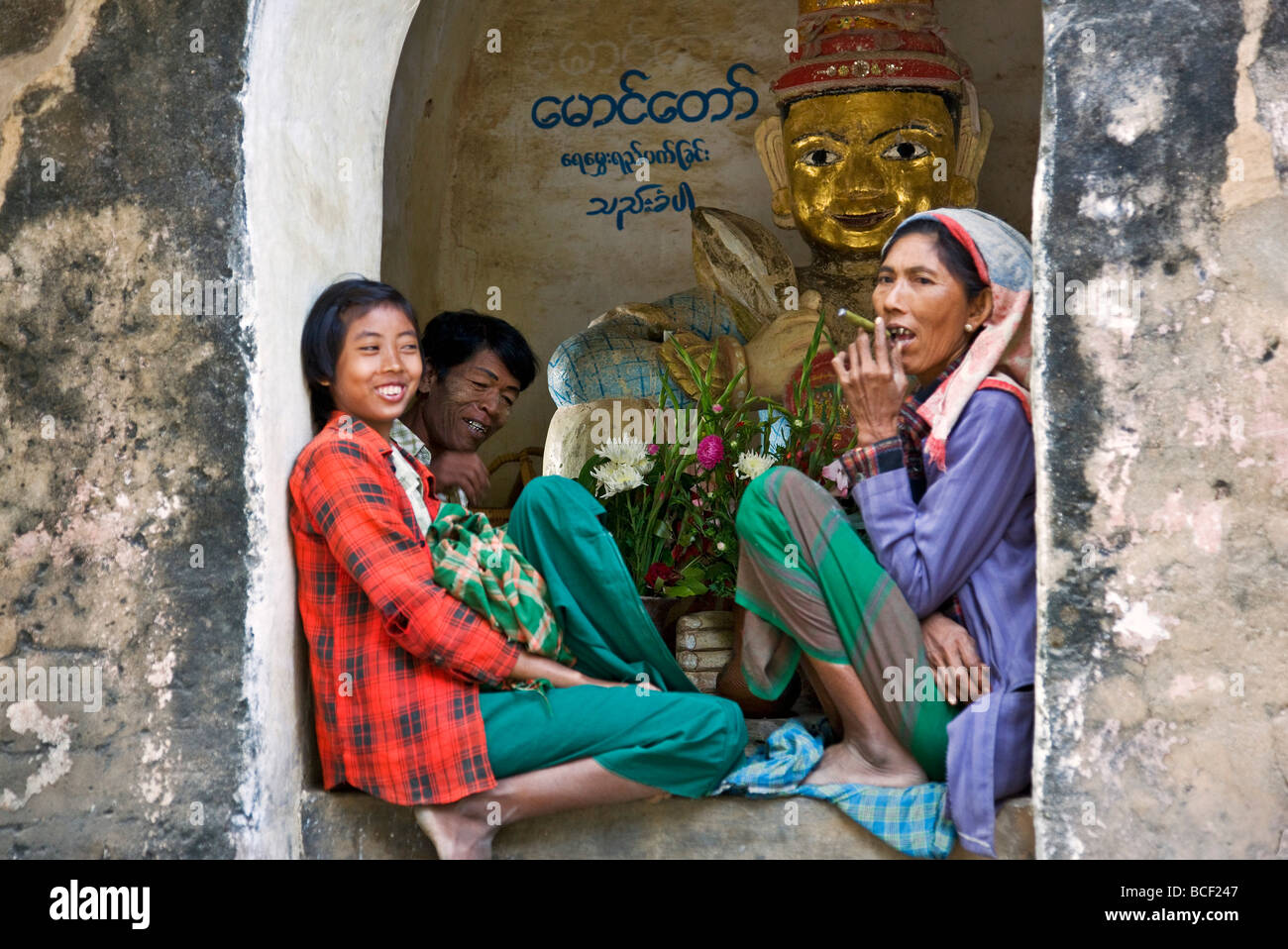 Myanmar. Burma. Bagan. A Burmese family pauses to rest at the Tharaba Gate, the gates into the old city of Bagan. - Stock Image